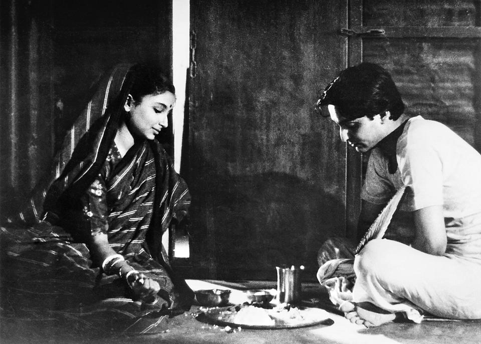 Staunchly Bengali: A still from Satyajit Ray's Apur Sansar (1959) featuring Soumitra Chatterjee and Sharmila Tagore.
