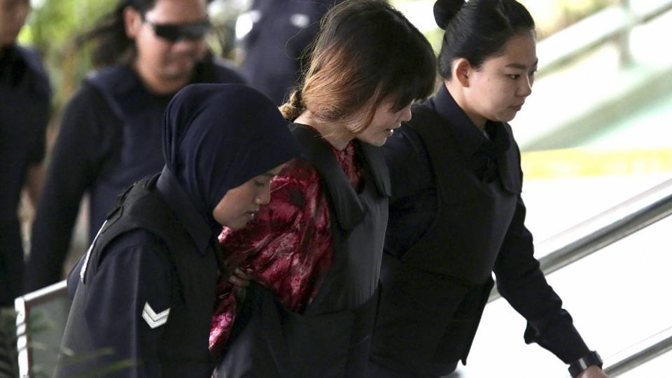 Vietnamese Doan Thi Huong, center, is escorted by police as she arrives for court hearing at Shah Alam court house in Shah Alam, outside Kuala Lumpur, Malaysia Thursday, Oct. 26, 2017.