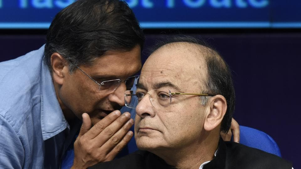 Chief economic advisor Arvind Subramanian talks to finance minister Arun Jaitley during a press conference in New Delhi on October 24.