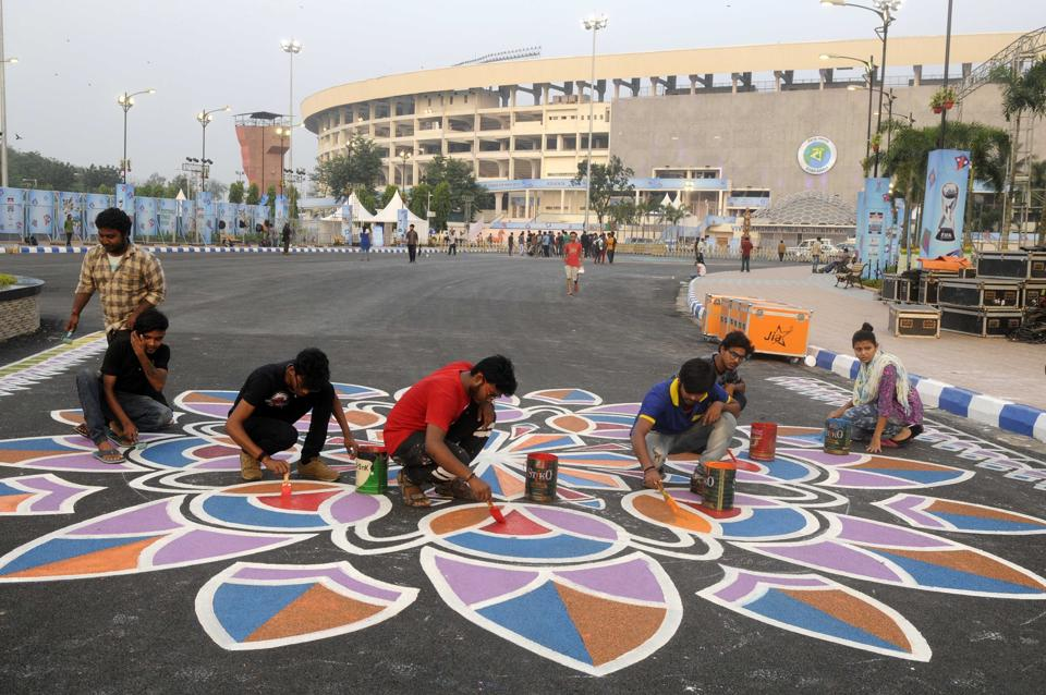 Studens from the four prominent art colleges in Kolkata converted the whole of Salt Lake Stadium as their canvas, painting graffiti to deck up the venue for the FIFA U-17 World Cup final between England and Spain.  (Samir Jana/HT PHOTO)