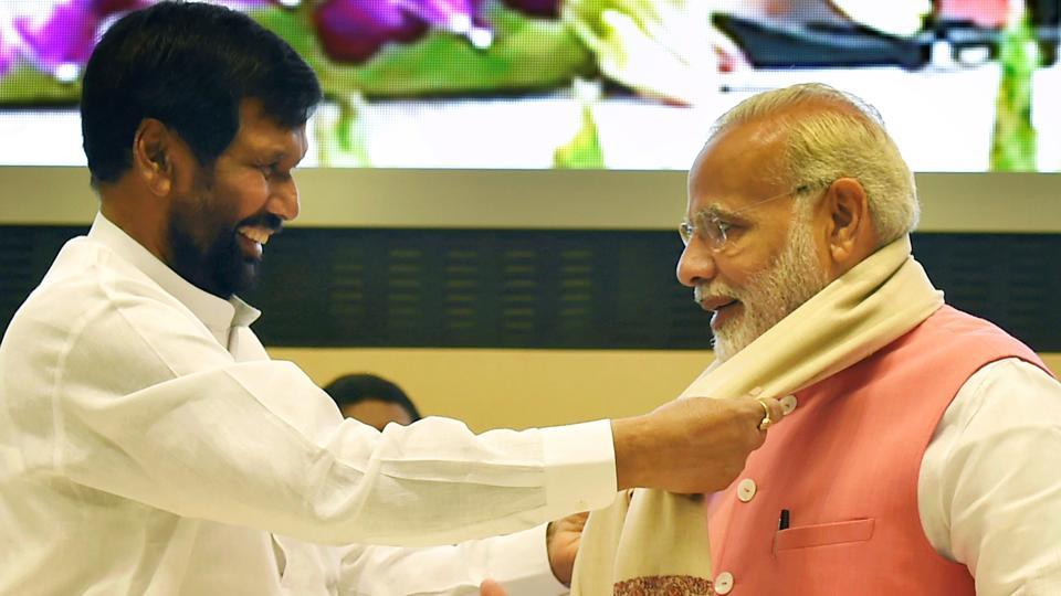 Prime Minister Narendra Modi being presented a shawl by Union minister for Consumer Affairs Ram Vilas Paswan at the International Conference on Consumer Protection for East, South & South-East Countries, in New Delhi on Thursday.