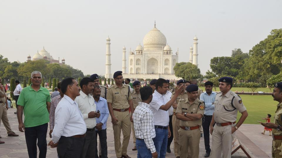 Police officials inspect the Taj Mahal ahead of Yogi Aditynath's visit, on Tuesday.