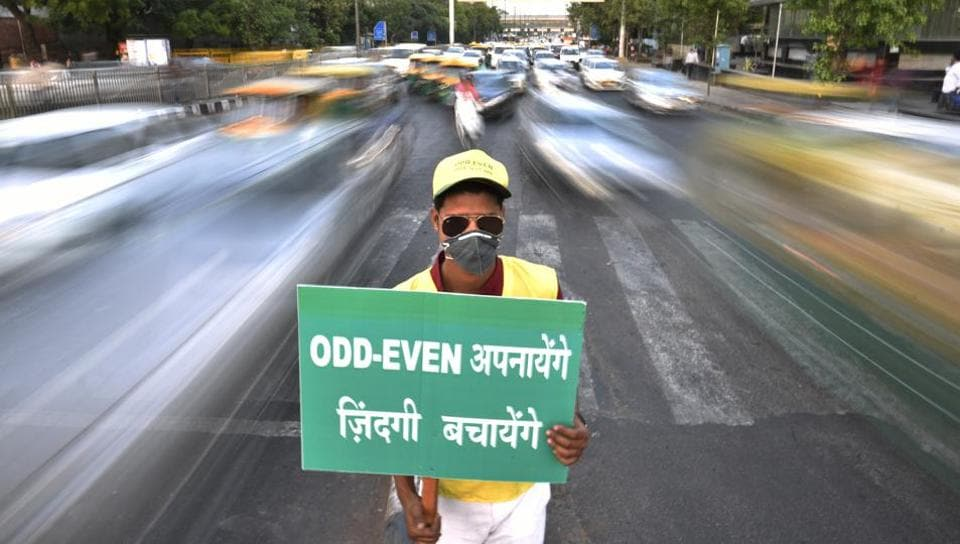 A civil defence personnel promotes odd-even scheme at ITO in central Delhi in April 2016.
