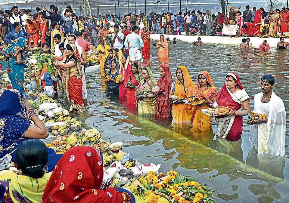 Devotees offering prayers to the Sun God in the waters of river Yamuna during the Chhath Puja in New Delhi  on Thursday.