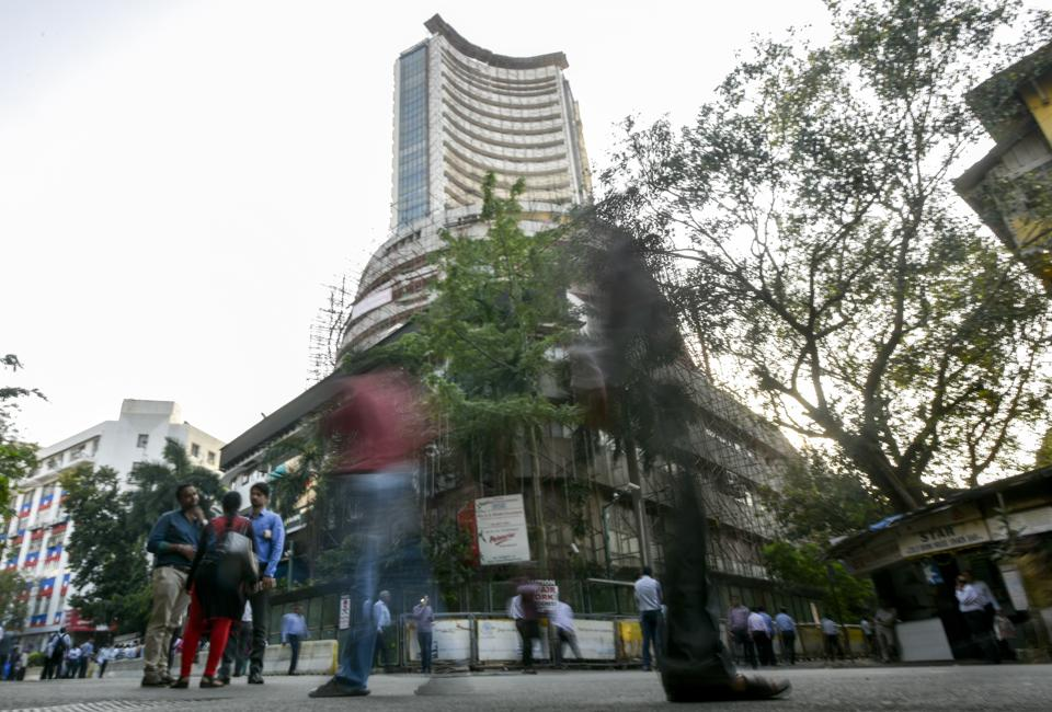 People walk through the Bombay Stock Exchange (BSE).