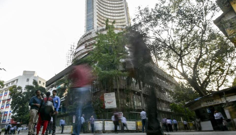 People near Bombay Stock Exchange (BSE) as Sensex crosses 33,000 mark, in Mumbai  on Tuesday.