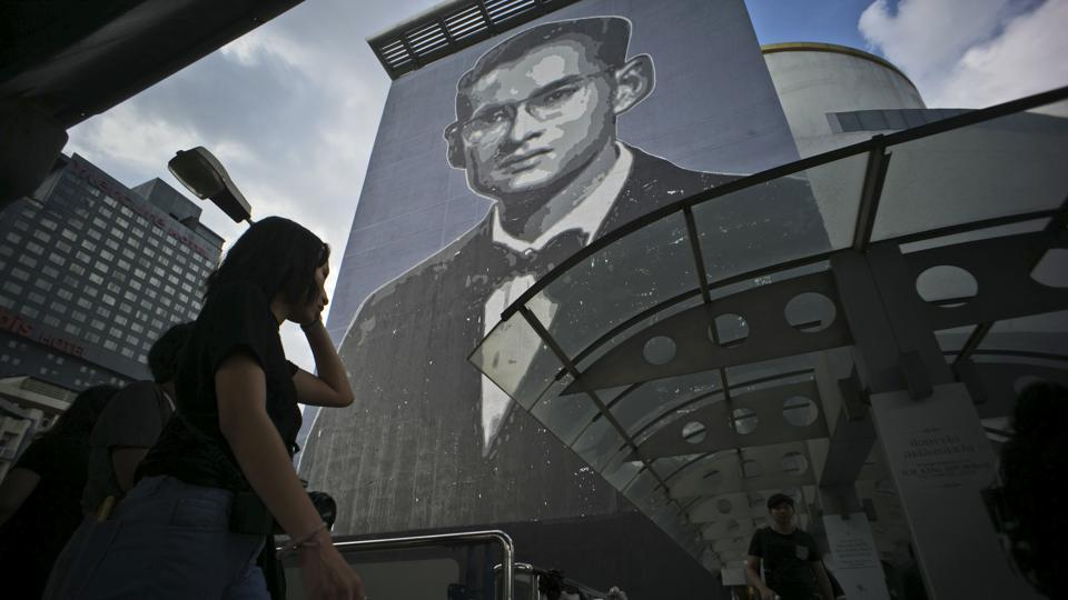 An image of the late Thai King Bhumibol, who many Thais loved like a father, covers the side of a building in Bangkok. As Thailand prepared for the elaborate cremation ceremony, his image was omnipresent across the country from billboards to ATM screens, from full-page tributes in national newspapers to commemorative books in street-side markets and shrines in shopping malls to exhibits in art galleries. (Charles Dharapak / AP)