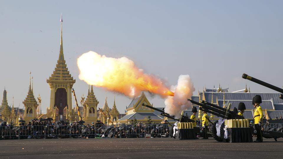 An artillery gun is fired at the funeral procession and royal cremation ceremony of late Thai King Bhumibol Adulyadej, in Bangkok, on October 26, 2017. A budget of 3 billion baht ($90 million) has been set aside for the funeral, which will be attended by dozens of heads of state, including King Jigme Khesar Namgyel Wangchuck of Bhutan and Japan's Prince Akishino and Princess Kiko. (Wason Wanichakorn / AP)
