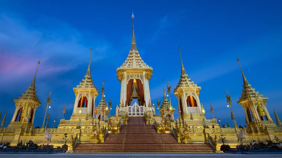 The royal pavilion where King Bhumibol Adulyadej will be cremated on October 26 is framed by the blue sky at dusk. The kingdom has been prepping for the event since he died at the age of 88 on October 13, 2016, triggering an outpouring of grief. The elaborate golden crematorium is a symbolic representation of Mount Meru — the mythical mountain where Hindus believe the gods live and where the king will ascend to after his cremation. (Roberto Schmidt / AFP)