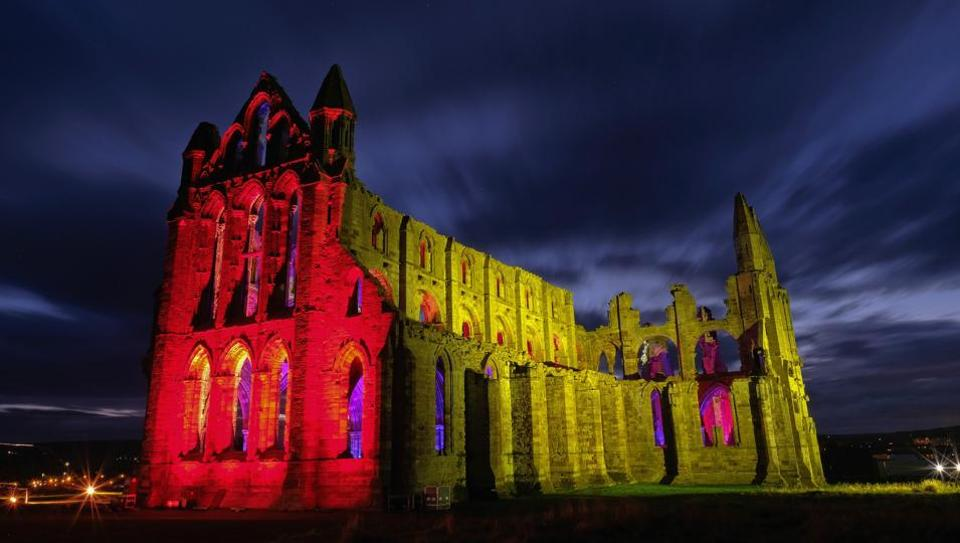 A light display illuminates the ruins of the historic Whitby Abbey in Whitby, England. The famous Benedictine abbey was the inspiration for Bram Stoker's gothic novel Dracula and will be illuminated during the English Heritage event over seven nights during Halloween and the Half Term period to celebrate that history. (Ian Forsyth / Getty Images)