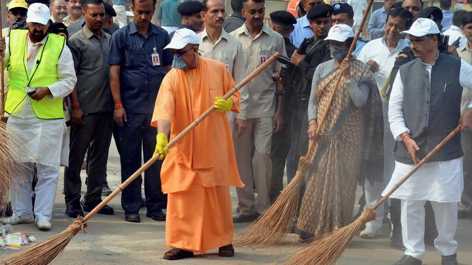 Uttar Pradesh chief minister Yogi Adityanath takes part in a cleanliness drive at the western gate of Taj Mahal in Agra on Thursday.