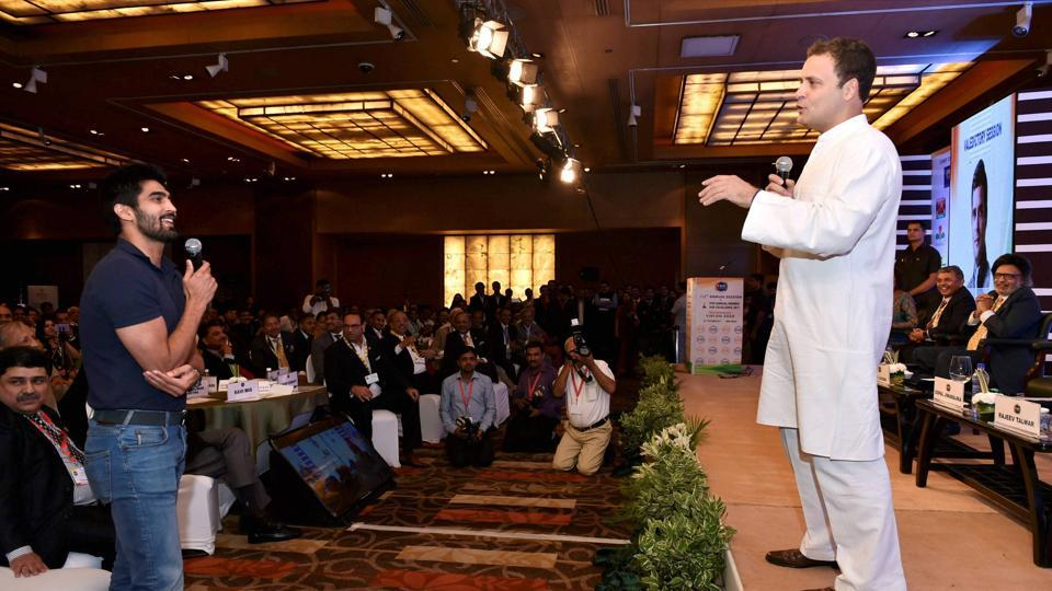 Congress Vice President Rahul Gandhi interacts with boxer Vijender Singh at 112th PHD Chamber's Annual Session & Awards for Excellence 2017 in New Delhi on Thursday.