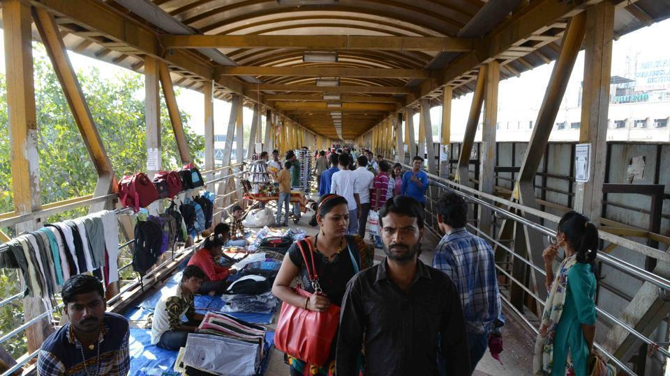 Hawkers occupying spaces on foot overbridges and entry/exit points of the stations are a menace for commuters during peak hours