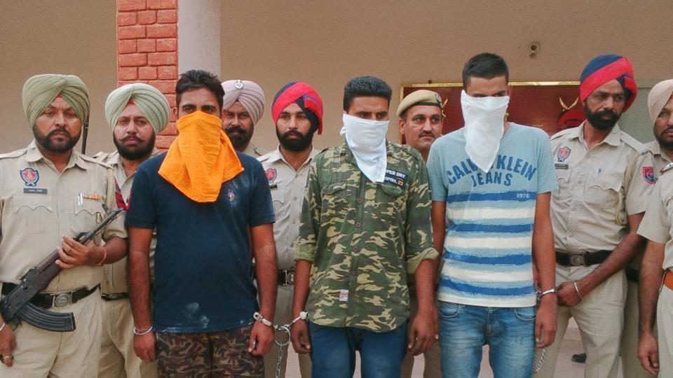 Manjinder Singh alias Kala Sekhon (in black t shirt), Beant Singh (centre) and Sukhjinder Singh in police custody on Friday.