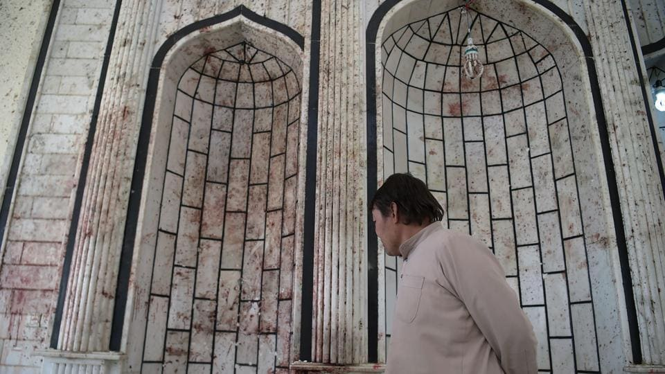 In this photograph taken on October 23, 2017 an Afghan resident looks on inside the Imam Zaman Shiite mosque after a suicide attack during Friday evening prayers, in Kabul.