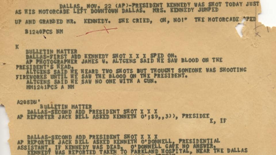 This Nov. 22, 1963, file photo shows an Associated Press 'A wire copy' edited for the teletypesetter circuit, reporting on the assignation of President John F. Kennedy in Dallas.  (AP)