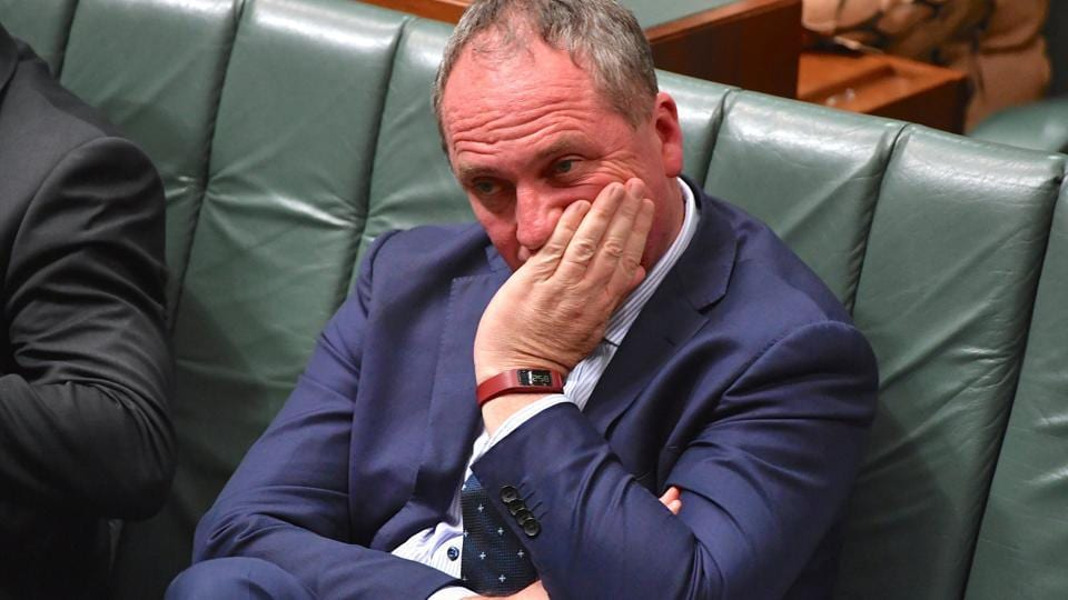 Australian Deputy Prime Minister Barnaby Joyce reacts as he sits in the House of Representatives at Parliament House in Canberra, Australia, October 25, 2017.