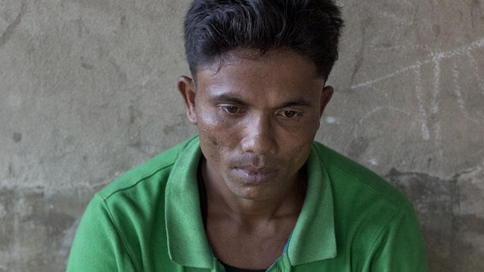 Rohingya man Alam Jafar sits for a photograph at a transit shelter for newly arrived Rohingya refugees at Kutupalong camp in Bangladesh.