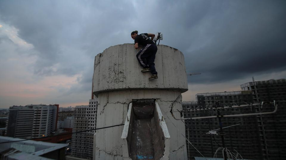 Vad Him of the Rudex team climbs up a structure on a rooftop in Moscow, Russia. A handful of young Muscovites spend their spare time braving the risk of arrest, injury and even death to scale tall buildings. Their motivation is simple: to feel more alive. (Maxim Shemetov / REUTERS)