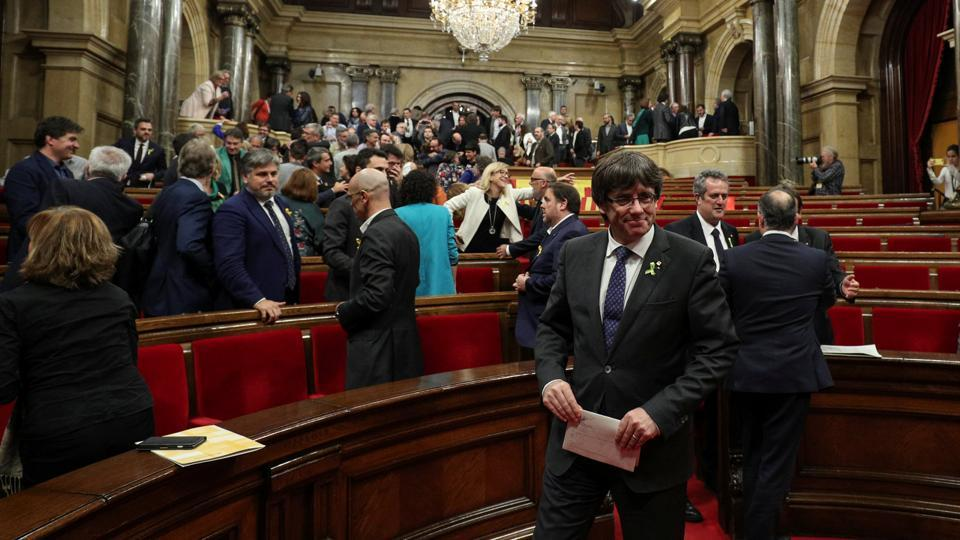 Catalan President Carles Puigdemont smiles after the Catalan regional Parliament declared independence from Spain in Barcelona, October 27, 2017. (REUTERS)