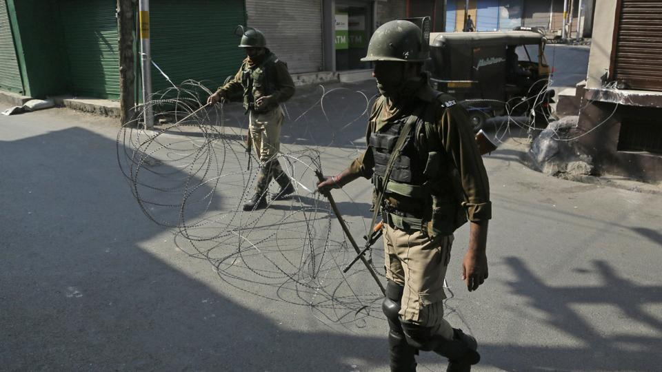 "File photo of paramilitary soldiers close a street with a concertina wire during a strike called by separatists. Separatist leaders Syed Ali Shah Geelani, Mirwaiz Umer Farooq and Yasin Malik have asked people to observe Kashmir's Accession Day as a ""black day""."