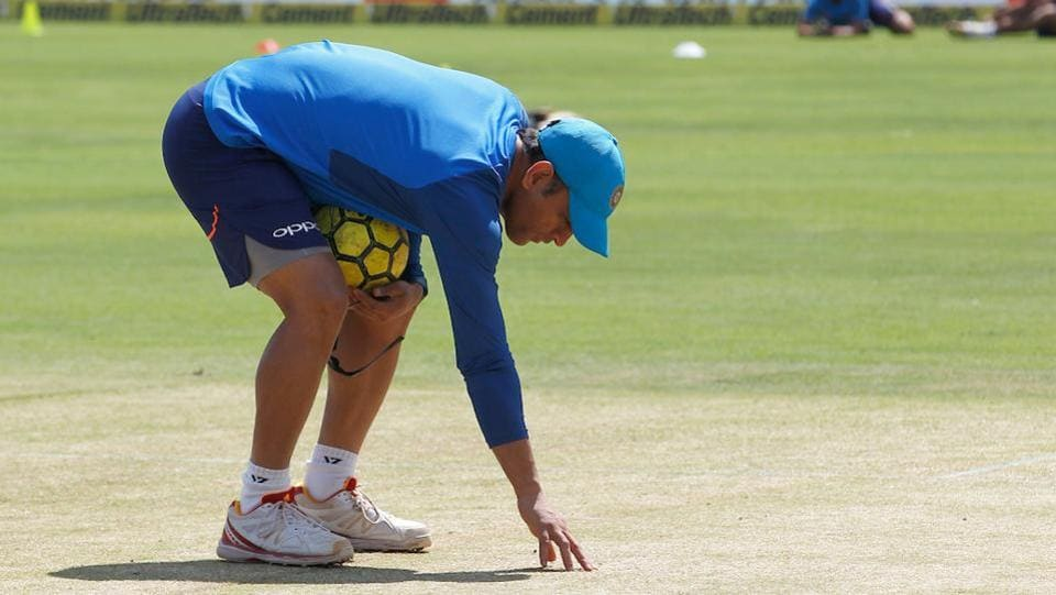 MS Dhoni inspects the pitch ahead of the 2nd ODI between India and New Zealand in Pune on Wednesday.