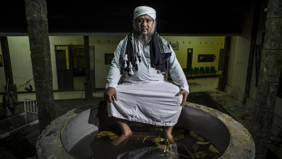 Ustad Ahmad Ischsan Maulana, the head of Nurul Ichsan Al Islami traditional rehabilitation centre, poses in a hot water herbal in Purbalingga, Indonesia. He started the traditional rehabilitation centre 17 years using traditional methods such as immersing his patients in boiling hot water for 10 to 30 minutes, herbal teas, prayer and counselling. (Ulet Ifansasti / Getty Images)