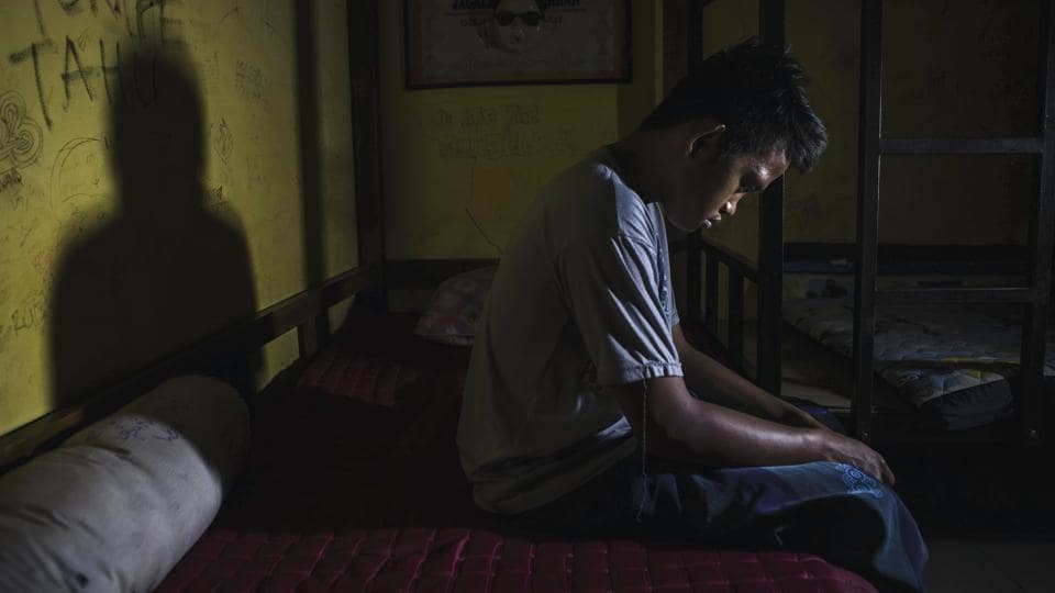 A recovering addict, Tanto (18), has been a drug addict for three years and seen in his room at the Nurul Ichsan Al Islami traditional rehabilitation centre in Purbalingga, Indonesia.  (Ulet Ifansasti / Getty Images)