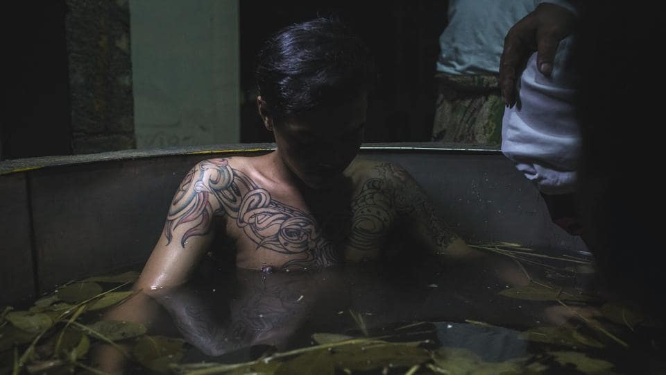 Bayu, a recovering drug addict sits in a hot water herbal bath as part of the treatment by the head of rehabilitation centre, Ustad Ahmad Ischsan Maulana in Purbalingga, Indonesia. (Ulet Ifansasti / Getty Images)