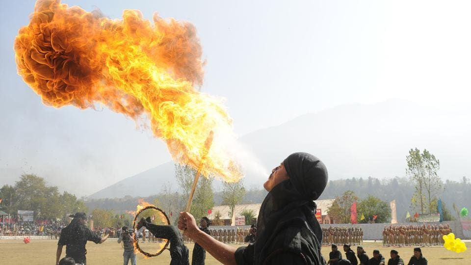 A new recruit of Jammu and Kashmir Police blows fire with his mouth during a passing-out parade at Manigam on October 25, 2017 in Ganderbal, Jammu and Kashmir. A total of 696 recruits were formally inducted into the Jammu and Kashmir Police after completing training in physical fitness, weapon handling, counter insurgency and dealing with the law and order situation. (Waseem Andrabi / HT Photo)