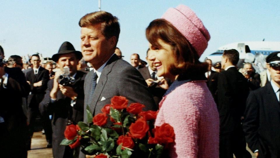 US president John F Kennedy and former first lady Jacqueline Bouvier Kennedy arrive at Love Field in Dallas, Texas less than an hour before his assassination in this November 22, 1963 photo by White House photographer Cecil Stoughton.