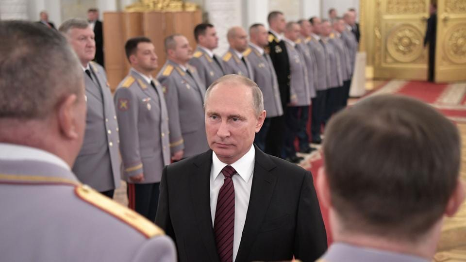 Russian President Vladimir Putin meets with senior officers promoted to higher positions at the Kremlin in Moscow on October 26, 2017.