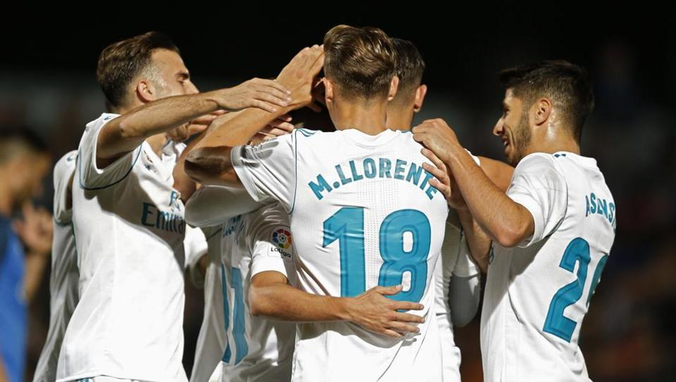 Real Madrid players celebrate the side's second goal against Fuenlabrada during the Spanish Copa del Rey round of 32 first leg match.