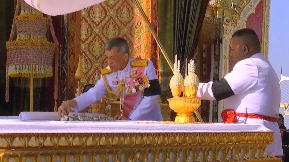 This video grab taken on October 27, 2017 shows Thai King Maha Vajiralongkorn (L) taking part in a ceremony where he selected relics from the ashes of his father the late Thai king Bhumibol Adulyadej at the Royal Crematorium in Bangkok.