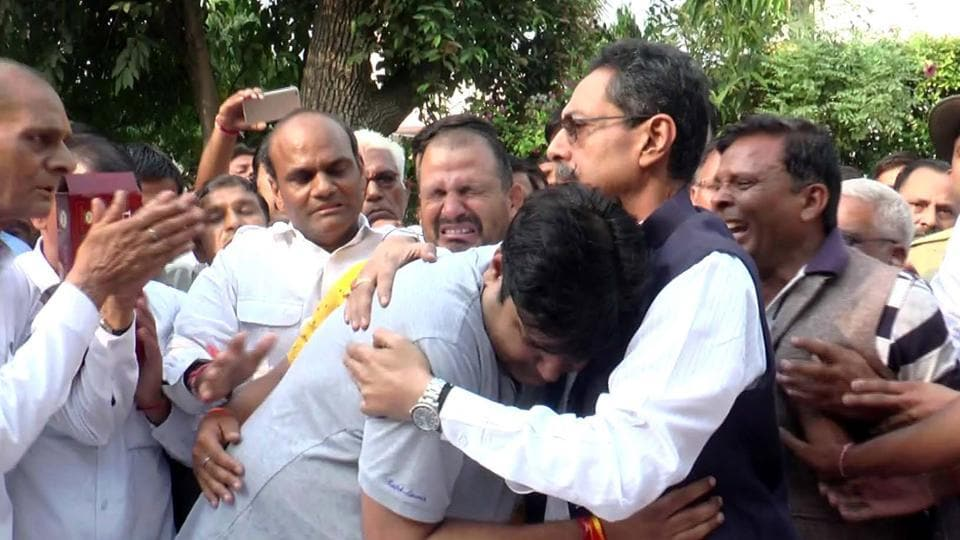 Congress leader Vishvendra Singh consoles Dr Digamber Singh's family members in Bharatpur on Friday.