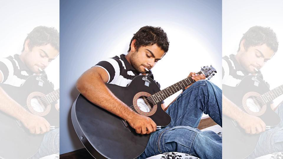 A young Virat trying his hand at the guitar.  (Chandan Ahuja)