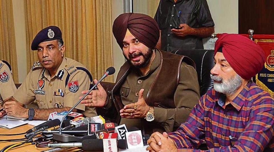Punjab Local Bodies Minister Navjot Singh Sidhu along with Police Commissioner SS Srivastava (L) and Deputy Commissioner Kamaldeep Singh Sangha (R) addressing a press conference at police lines, Amritsar on Friday