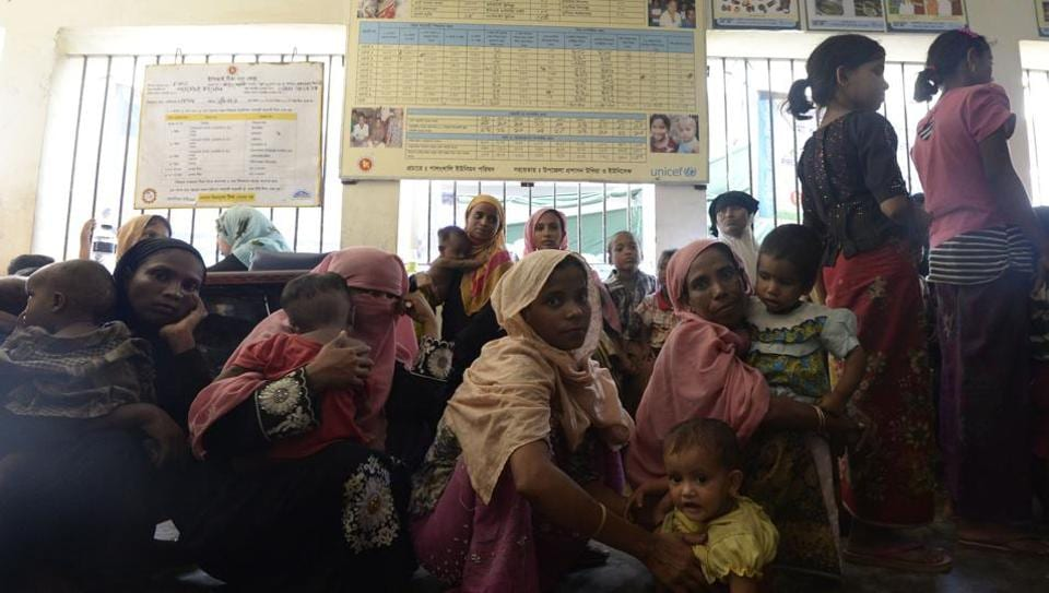 In this photograph taken on October 24, 2017, Rohingya Muslim refugees wait inside a government-run family planning centre in the Bangladeshi town of Palongkhali.