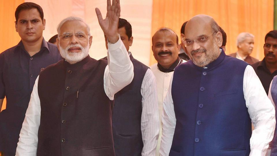 Prime Minister Narendra Modi with BJP president Amit Shah during the Deepawali Mangal Milan programme at the BJP headquarters in New Delhi on Saturday.