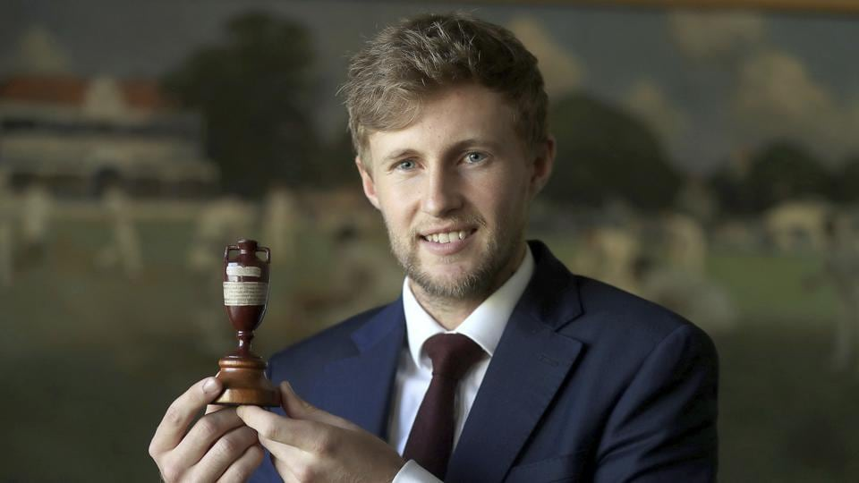 England's current team captain Joe Root holds the trophy as he faces the media at Lord's in London, Friday Oct. 27, 2017. The England cricket team depart for Australia on Saturday in preparation for the start of the upcoming Ashes Series.