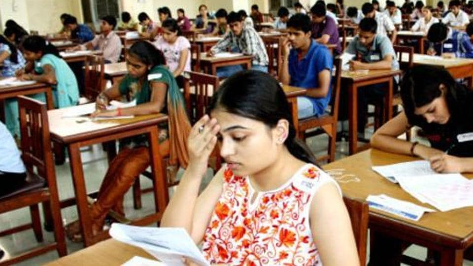 Students write their entrance exam for MBBS at the PGI campus in Rohtak.