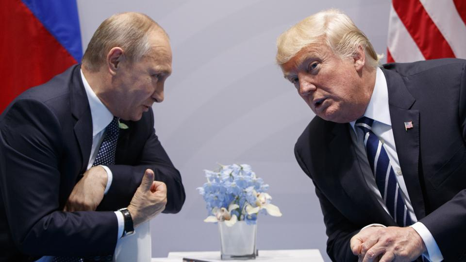US President Donald Trump with Russian President Vladimir Putin during the G-20 Summit in July  2017 in Hamburg.