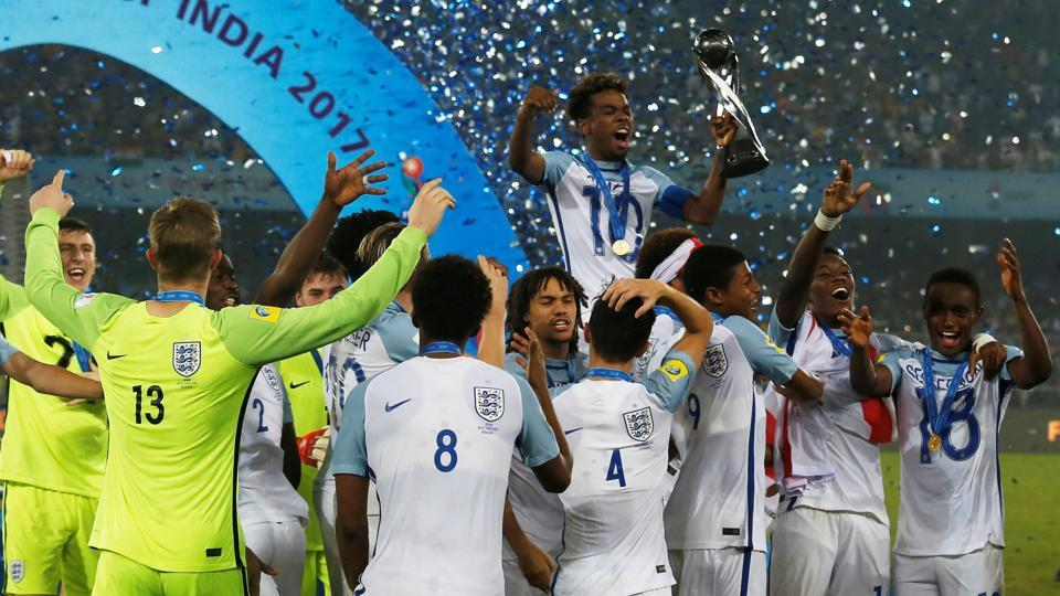 England players celebrate after lifting the FIFAU-17 World Cup trophy for the first time. They beat Spain in the final 5-2 in Kolkata on Saturday.