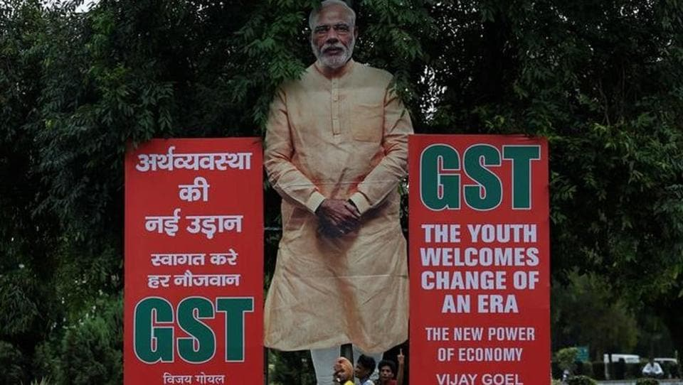 A hoarding in favour of the implementation of the Goods and Services Tax (GST) at a street in New Delhi.