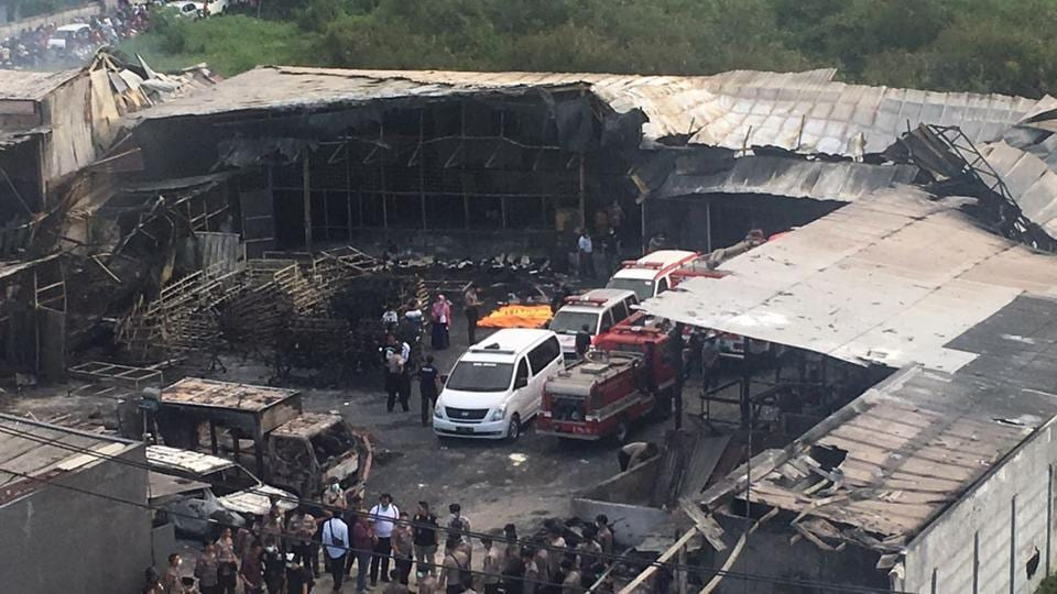 Police officers and rescuers inspect the site of an explosion at a firecracker factory in Tangerang, on the outskirts of Jakarta, Indonesia, on Thursday.