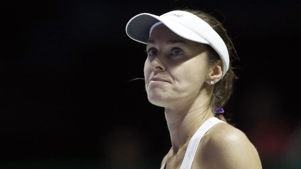 Martina Hingis reacts after conceding a point against Timea Babos and Andrea Hlavackova during their doubles semi-final match at the WTA Finals in Singapore. Martina Hingis and Chan Yung-jan lost 6-4, 7-6(5).