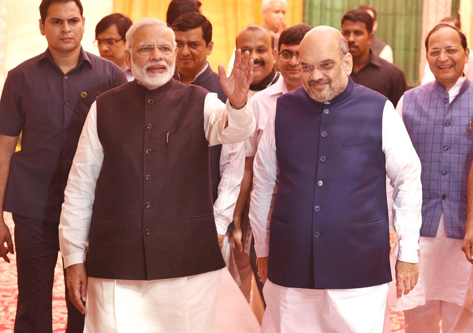 PMNarendra Modi and BJPPresident Amit Shah at the party headquarters in New Delhi on Saturday.