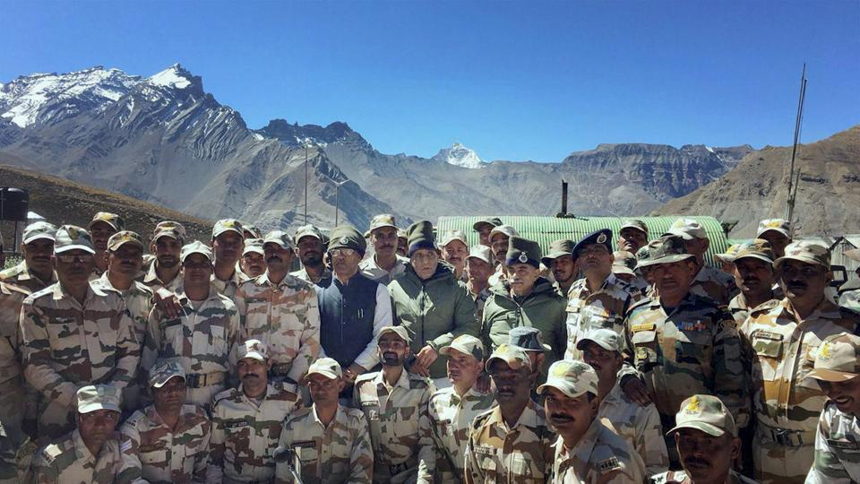 Union home minister Rajnath Singh in a group photograph during his visit to the ITBP Border Out Post in Lapthal, Uttarakhand.