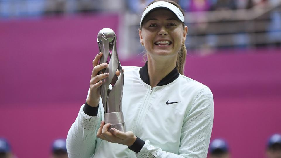 Maria Sharapova holds her trophy after winning her women's singles final match against Aryna Sabalenka of Belarus at the Tianjin Open tennis tournament in Tianjin on October 15, 2017. Chris Evert believes Sharapova is poised for more success in the upcoming calender year.