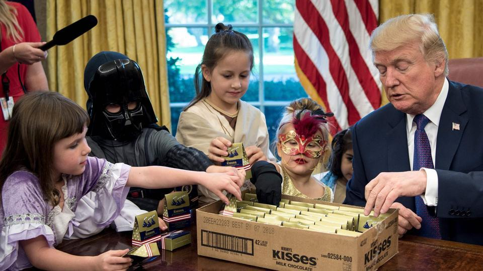 US President Donald Trump meets with children of members of the press for Halloween in the Oval Office of the White House in Washington, DC, on October 27, 2017.